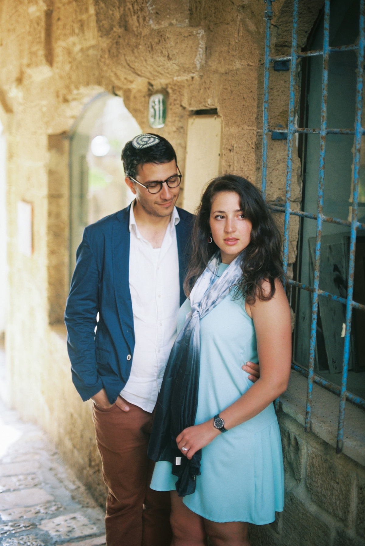 Couple standing in alleyway - Old City Jaffa Engagement Session - Sigala Photography