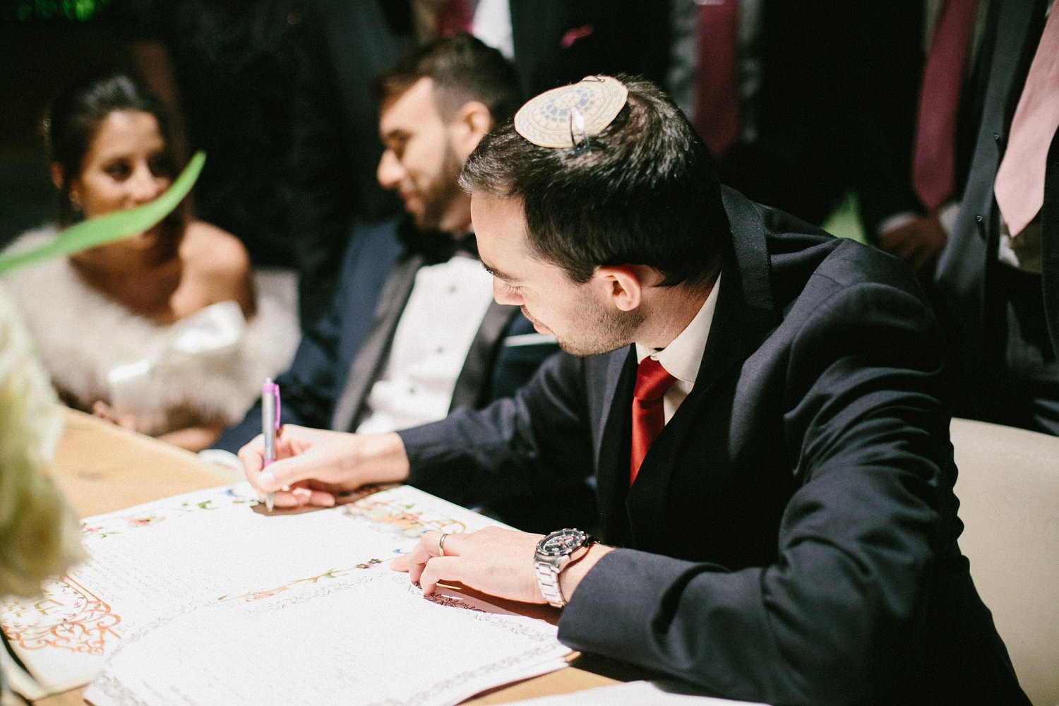 Groom's friend signing the Ketubah at Baya'ar