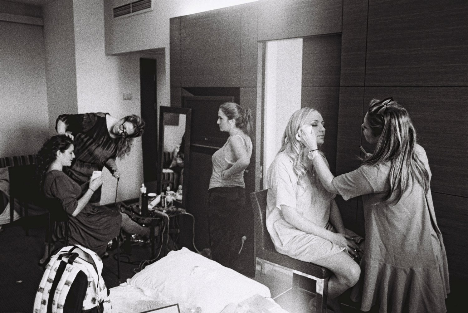 bride and sisters getting hair and make-up done before wedding at Dan Boutique hotel in Jerusalem