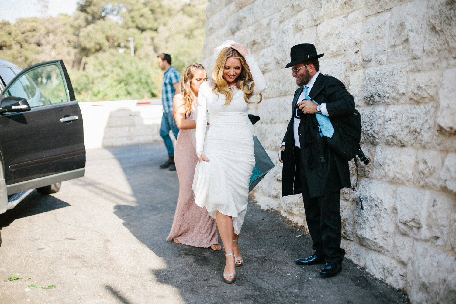 bride and family arriving to Olmaya Jerusalem for wedding ceremony