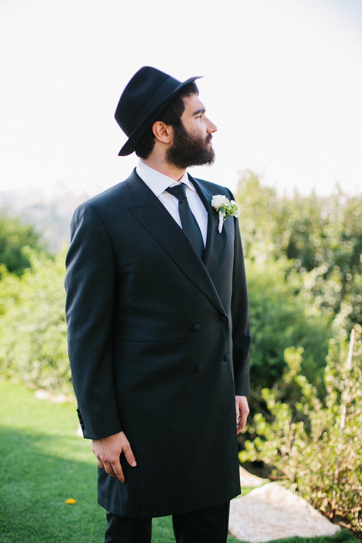 portrait of groom looking out over East Jerusalem