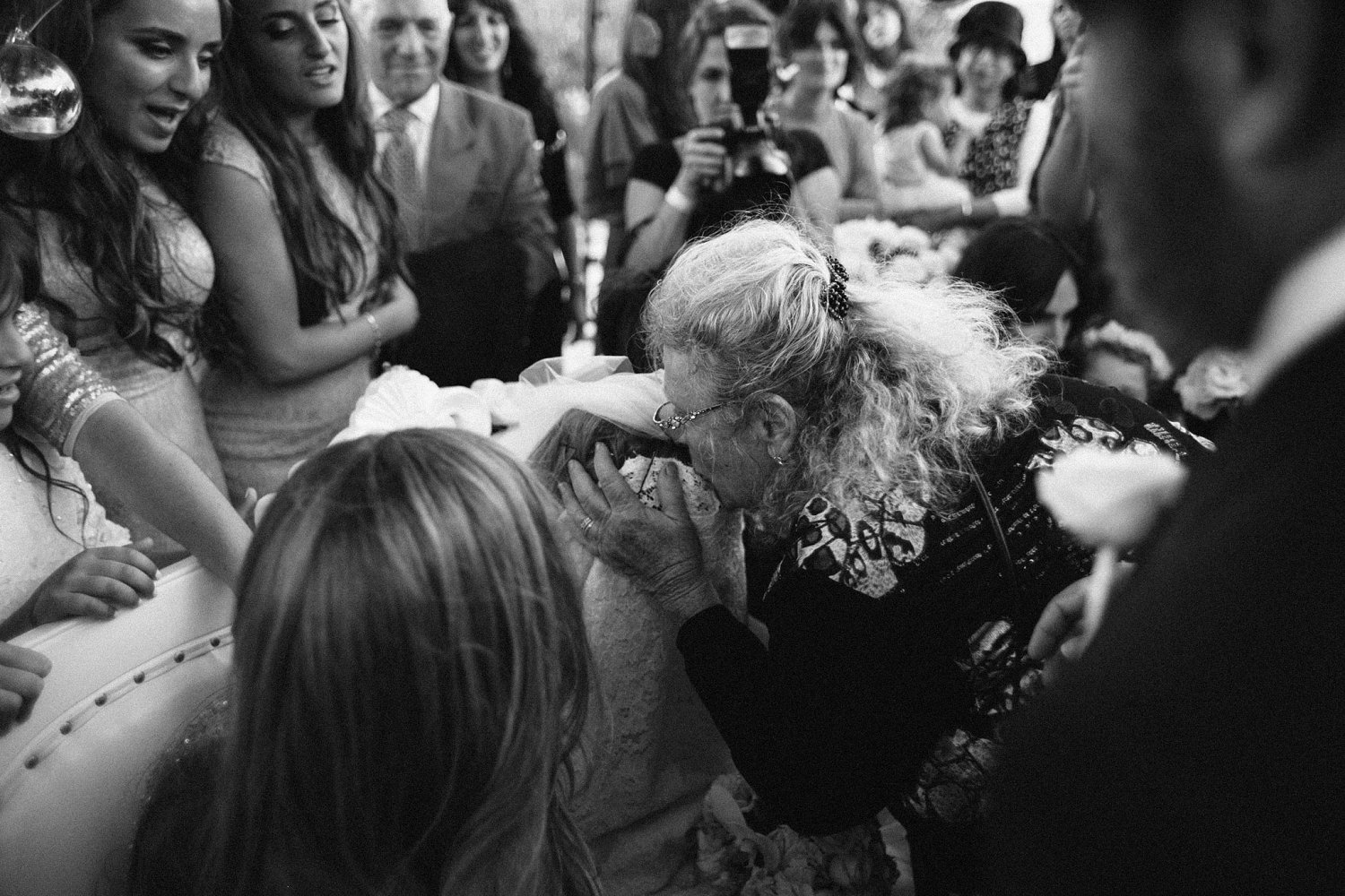 aunt giving bride a blessing during Olmaya wedding