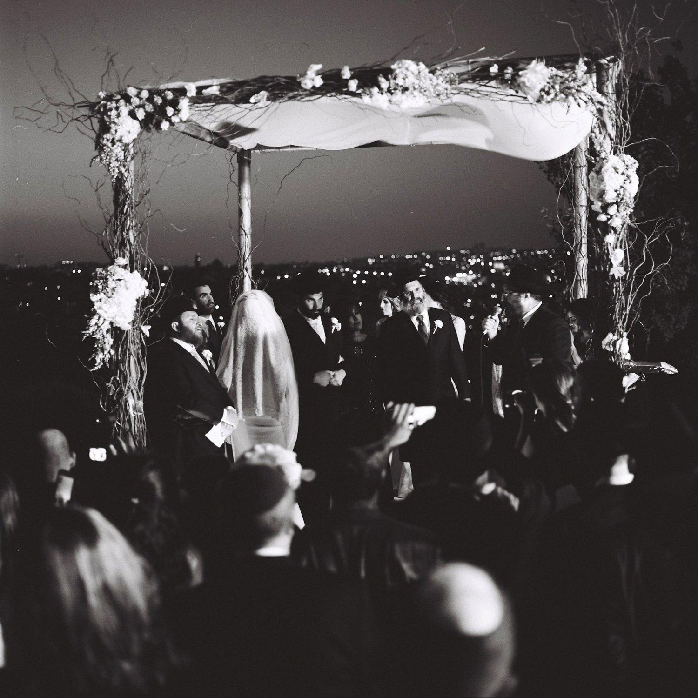 Jewish wedding ceremony under chuppah overlooking Jerusalem