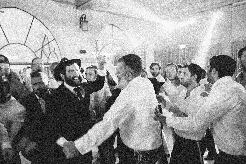 groom and father dancing in Olmaya Jerusalem