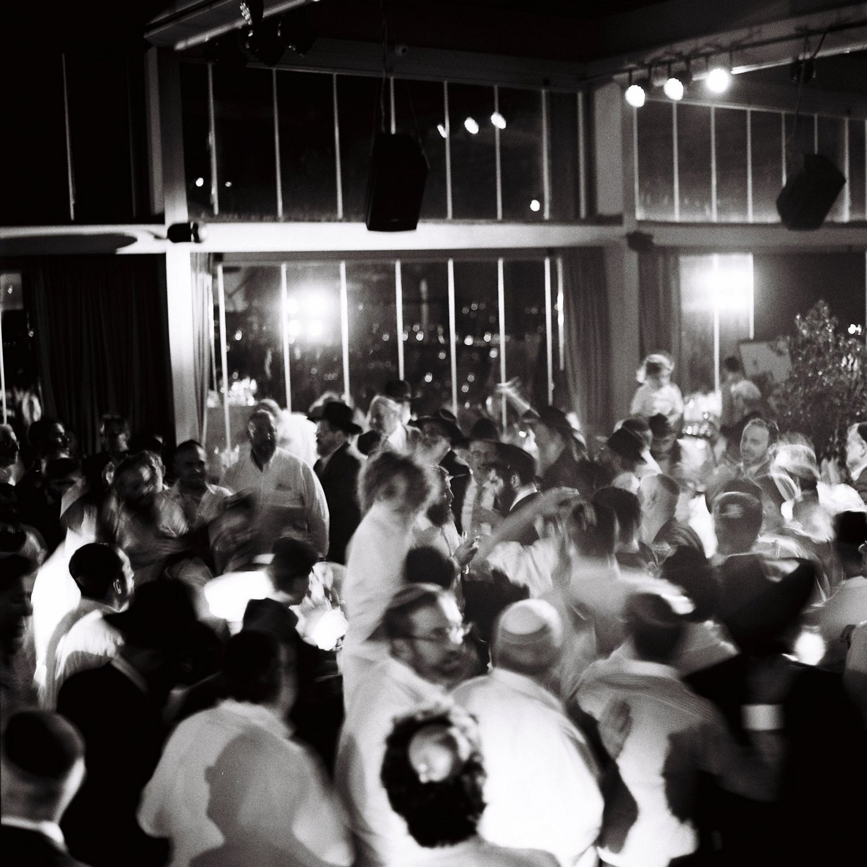 dance floor filled with people dancing at Olmaya wedding