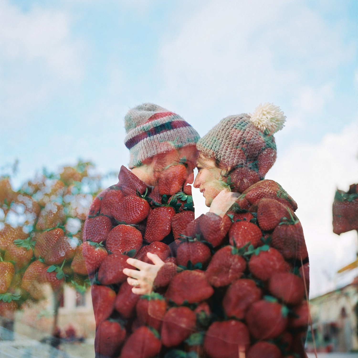 Double exposure of couple and strawberries during Machane Yehuda Jerusalem engagement session