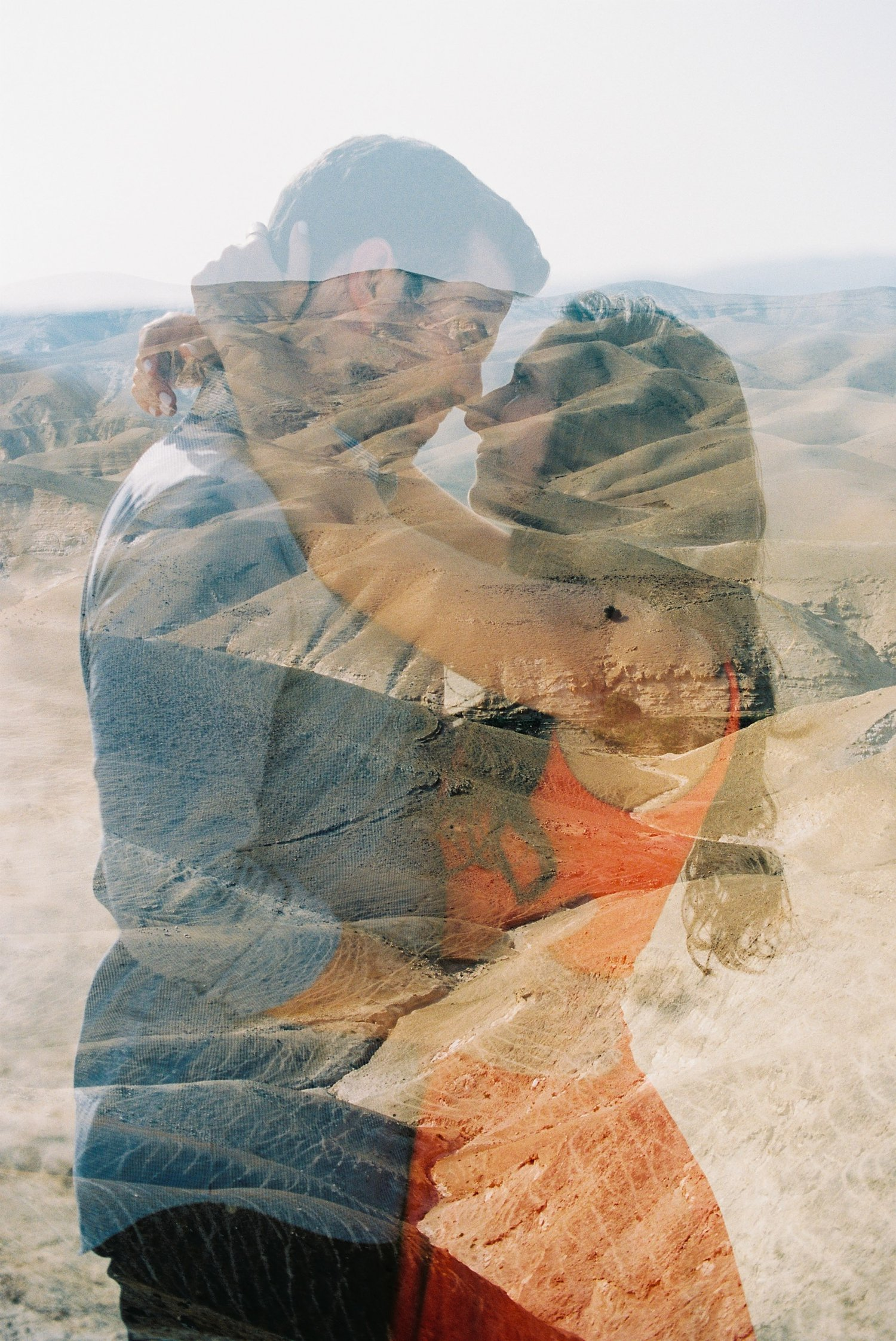 Double exposure on film of couple and hills during Judean Desert engagement session