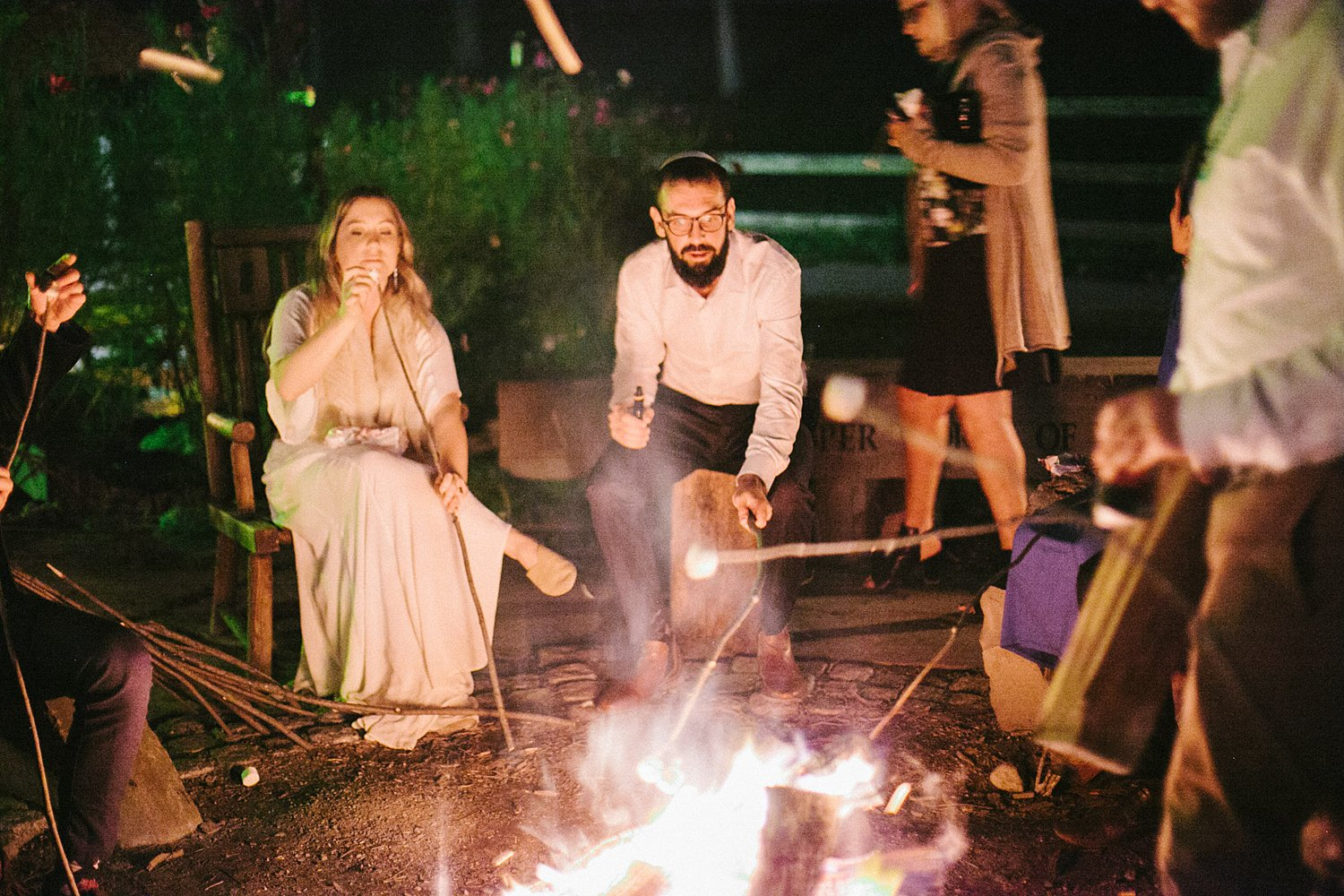 Newlywed couple roasting marshmallows after New Park Ithaca Wedding